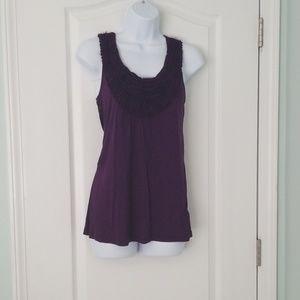 Purple sleeveless ruffle blouse